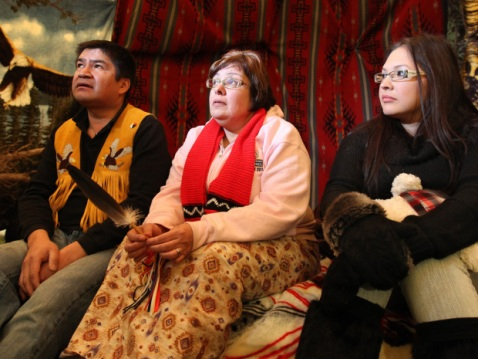 Attawapiskat Chief Theresa Spence (middle) sits between supporters Danny Matatawabin (left) and Angela Bercier in a teepee on Victoria Island in Ottawa during her hunger strike.  (JULIE OLIVER/OTTAWA CITIZEN)